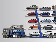 Trailer lleno de carros